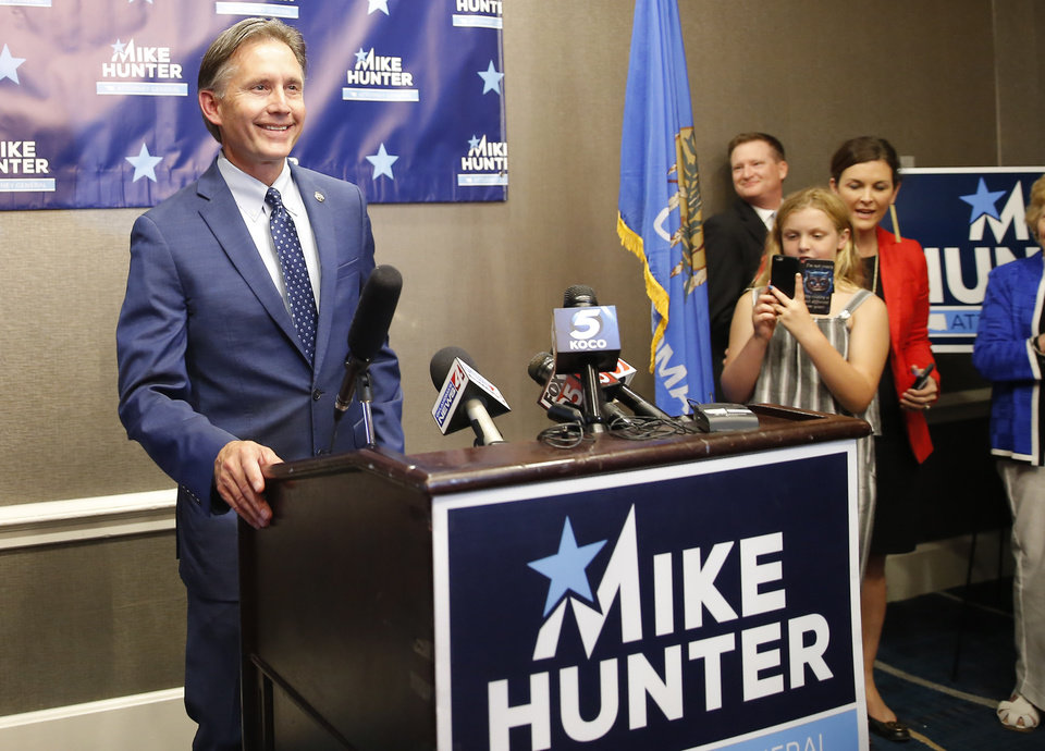 Photo - Attorney General Mike Hunter smiles he he starts to speak  during his watch party for the Republican primary runoff election in Nichols Hills, Okla., Tuesday, Aug. 28, 2018. Photo by Bryan Terry, The Oklahoman