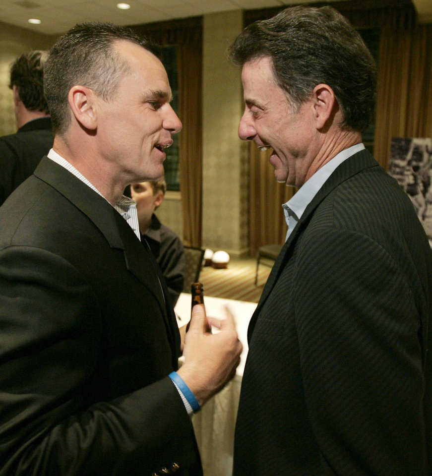 Photo -  Former Providence co-captain Billy Donovan, left, chats in 2007 with former Providence coach Rick Pitino in Providence, R.I., at 20th anniversary celebration of the team's trip to the Final Four. [AP photo]