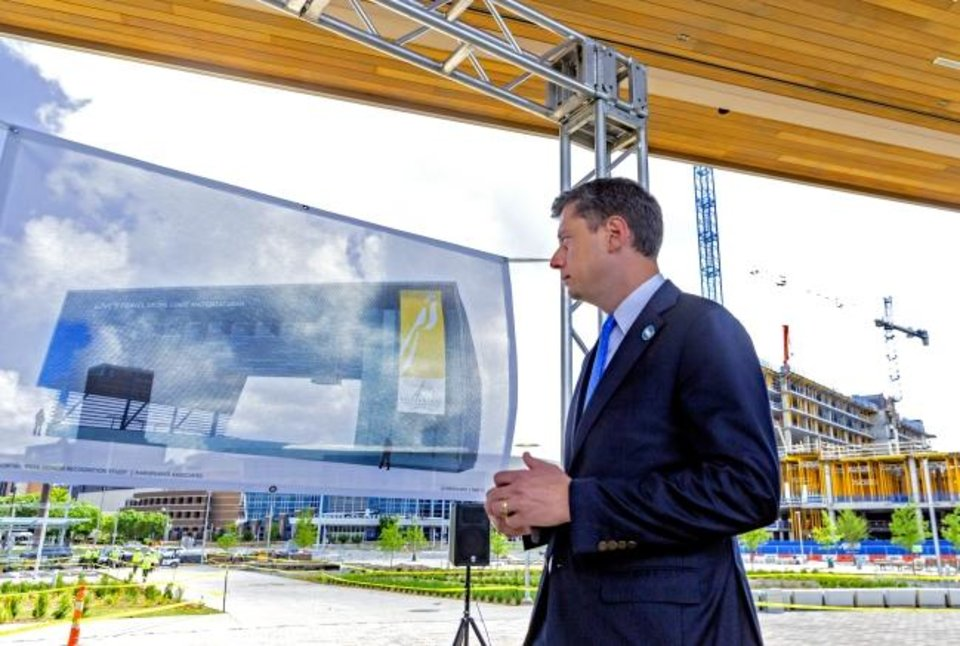 Photo -  Mayor David Holt looks at the rendering of the stage during the naming of the Love's Travel Stops Stage and Great Lawn at Scissortail Park in Oklahoma City in June.  [Chris Landsberger/The Oklahoman]