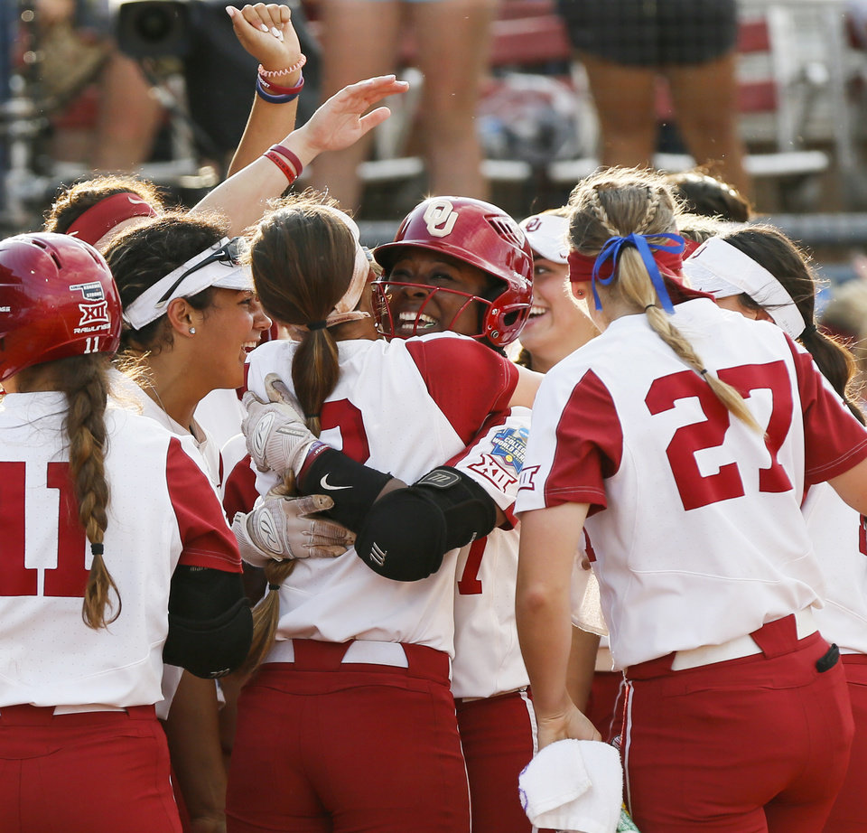 Photo - OU's Shay Knighten (17) gets a hug from Sydney Romero (2) at home plate after Knighten hit a home run in the second inning during the first NCAA softball game in the championship series of the Women's College World Series between Oklahoma and UCLA at USA Softball Hall of Fame Stadium in Oklahoma City, Monday, June 3, 2019. [Nate Billings/The Oklahoman]