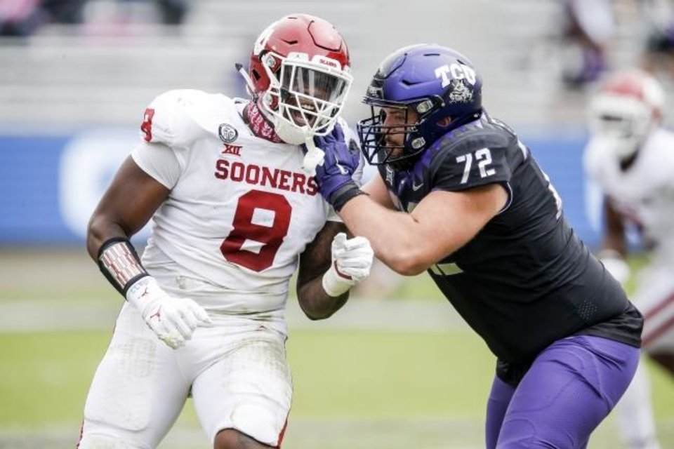 Photo -  Offensive tackle T.J. Storment (72) and TCU had their hands full blocking OU defensive lineman Perrion Winfrey (8) on Saturday. [AP Photo/Brandon Wade]