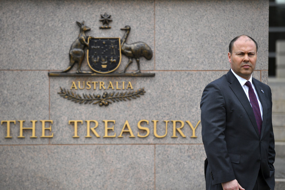 Photo -  Australia's Treasurer Josh Frydenberg is photographed outside The Treasury in Canberra, Monday, Oct. 5, 2020. The Australian government will reveal a big spending financial blueprint for the next few years that will drive business investment and job creation while repairing pandemic damage to the economy. (Mick Tsikas/AAP Image via AP)
