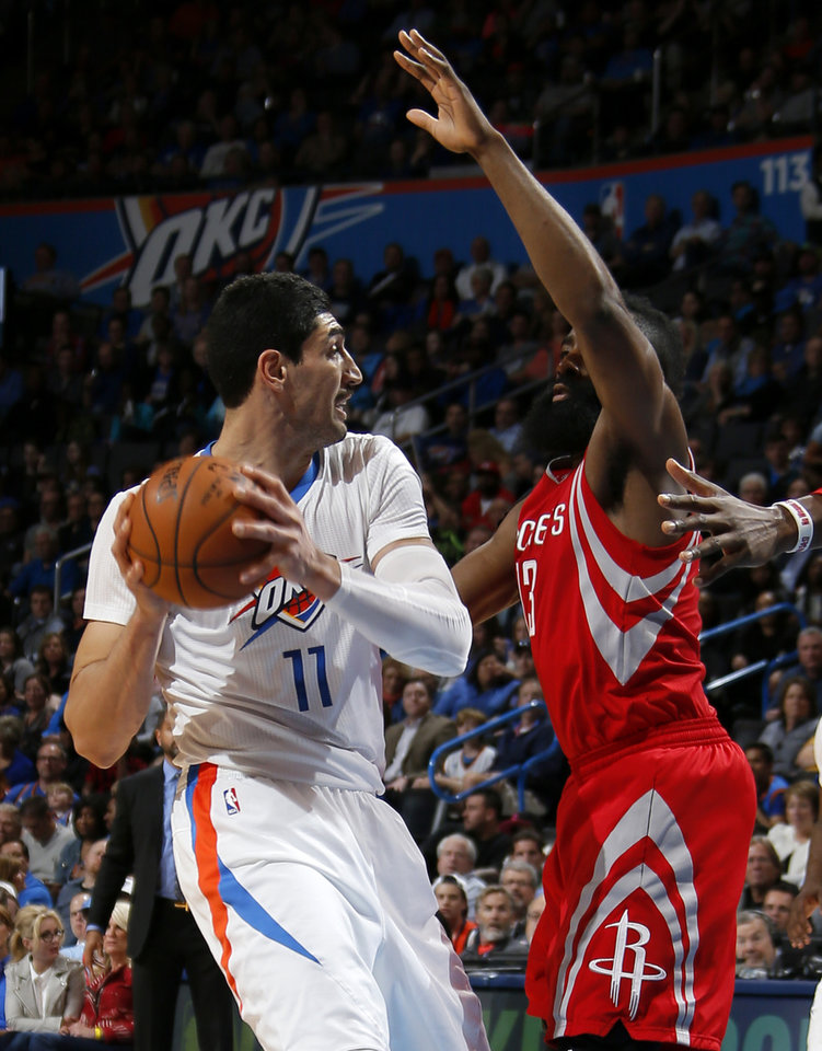 Photo - Oklahoma City's Enes Kanter (11) tries to get past Houston's James Harden (13) during an NBA basketball game between the Oklahoma City Thunder and the Houston Rockets at Chesapeake Energy Arena in Oklahoma City, Tuesday, March 22, 2016. Photo by Bryan Terry, The Oklahoman
