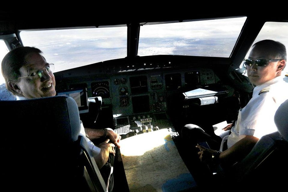 Photo -  Our United pilots somewhere over Wyoming. Photo by Sarah Phipps, The Oklahoman