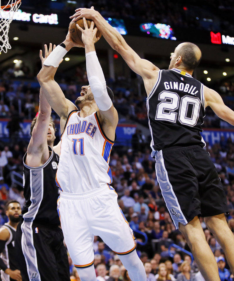 Photo - San Antonio's Manu Ginobili (20) and Pau Gasol (16) defend Oklahoma City's Enes Kanter (11) during an NBA basketball game between the Oklahoma City Thunder and San Antonio Spurs at Chesapeake Energy Arena in Oklahoma City, Friday, March 31, 2017. San Antonio won 100-95. Photo by Nate Billings, The Oklahoman