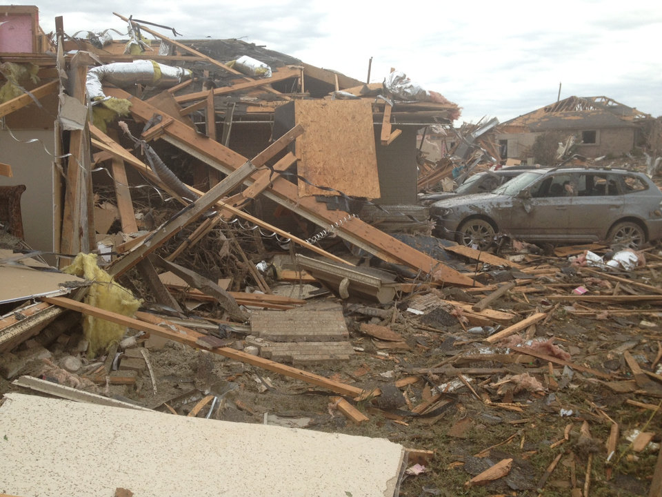 Photo - Tornado damage in Moore Tuesday, May 21, 2013 - Photo by Chris Landsberger