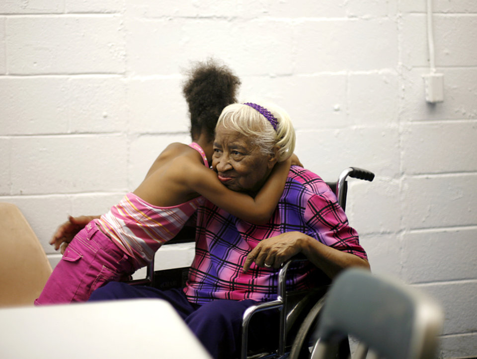 Photo - SIT-INS: Clara Luper gets a hug from a child before a meeting at Oklahoma City's Freedom Center, August 3, 2008. By John Clanton, The Oklahoman ORG XMIT: KOD