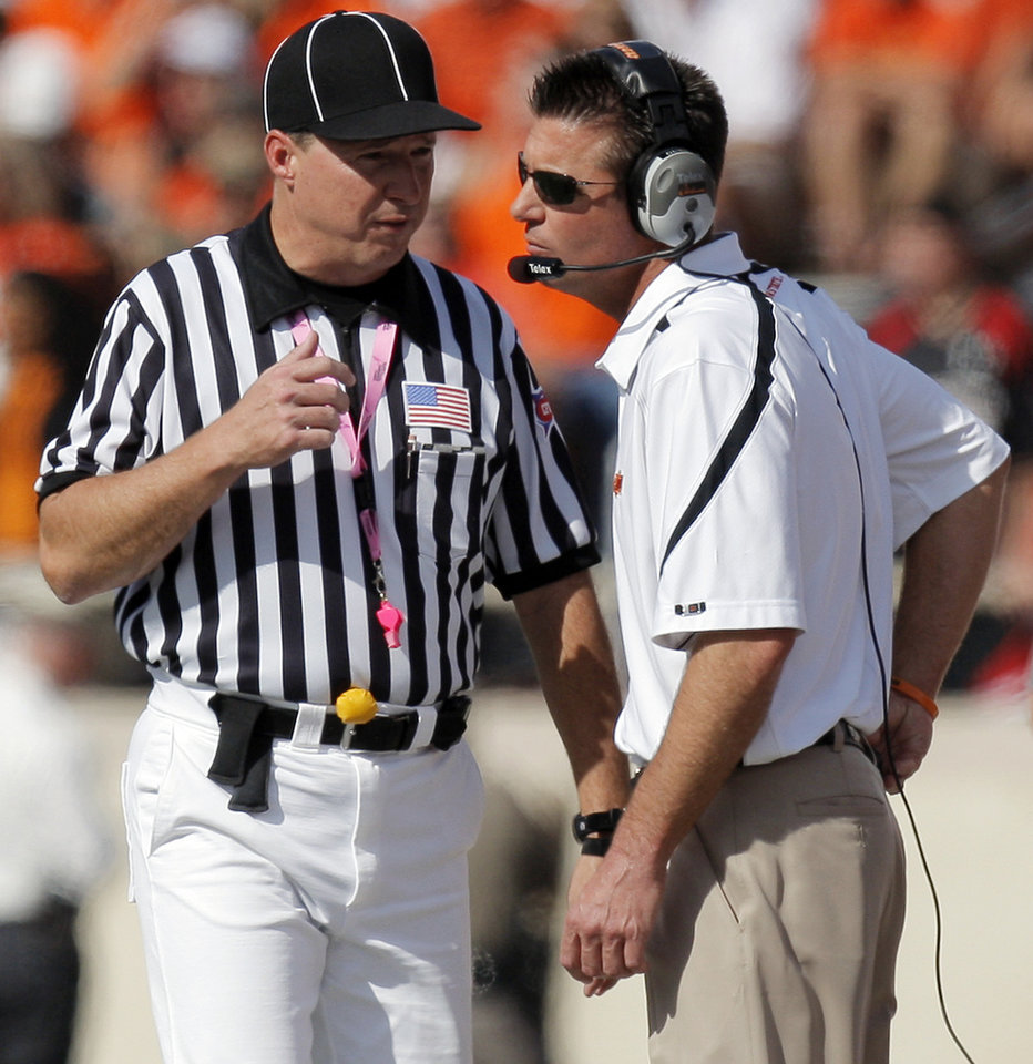 Photo - OSU head coach Mike Gundy talks to an official during the college football game between the Oklahoma State University Cowboys and Texas Tech University Red Raiders at Jones AT&T Stadium in Lubbock, Texas, Saturday, October 16, 2010. Photo by Nate Billings, The Oklahoman