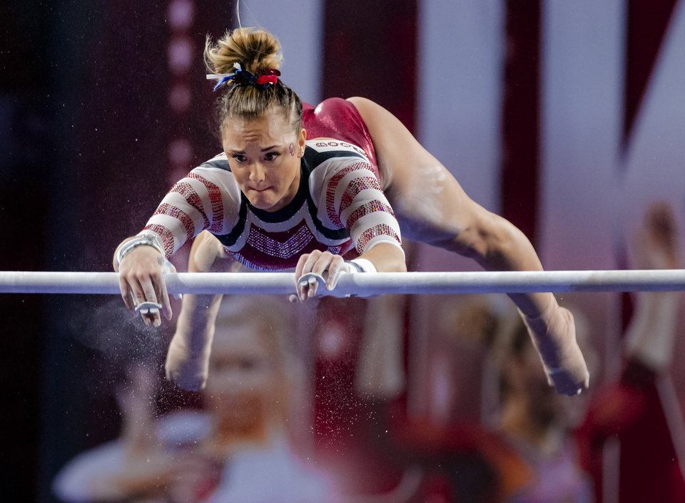 Photo - University of Oklahoma's Maggie Nichols competes in the bars during the women's gymnastics competition between the University of Oklahoma and Arkansas at the Lloyd Noble Center in Norman, Okla Monday, Jan. 20, 2020.   [Chris Landsberger/The Oklahoman]