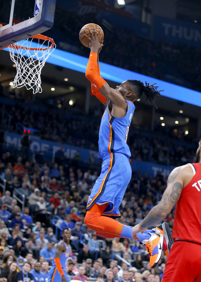 Photo - Nerlens Noel (9) dunks the ball during the NBA basketball game between the Oklahoma City Thunder and the Portland Trail Blazers at the Chesapeake Energy Arena in Oklahoma City, Saturday, Jan. 18, 2020.  [Sarah Phipps/The Oklahoman]