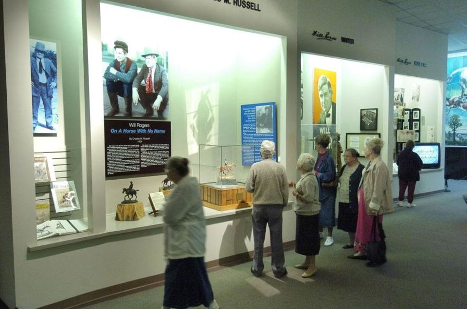 Photo - Visitors look over exhibits at the Will Rogers Memorial Museum in Claremore. (PAUL HELLSTERN, THE OKLAHOMAN)