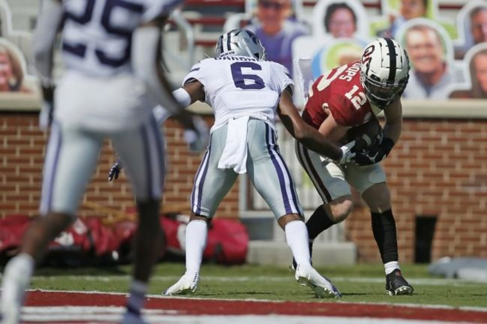 Photo -  OU's Drake Stoops (12) gets past Kansas State's Justin Gardner (6) to score a touchdown during last Saturday in the Wildcats' 38-35 win in Norman. [Bryan Terry/The Oklahoman]