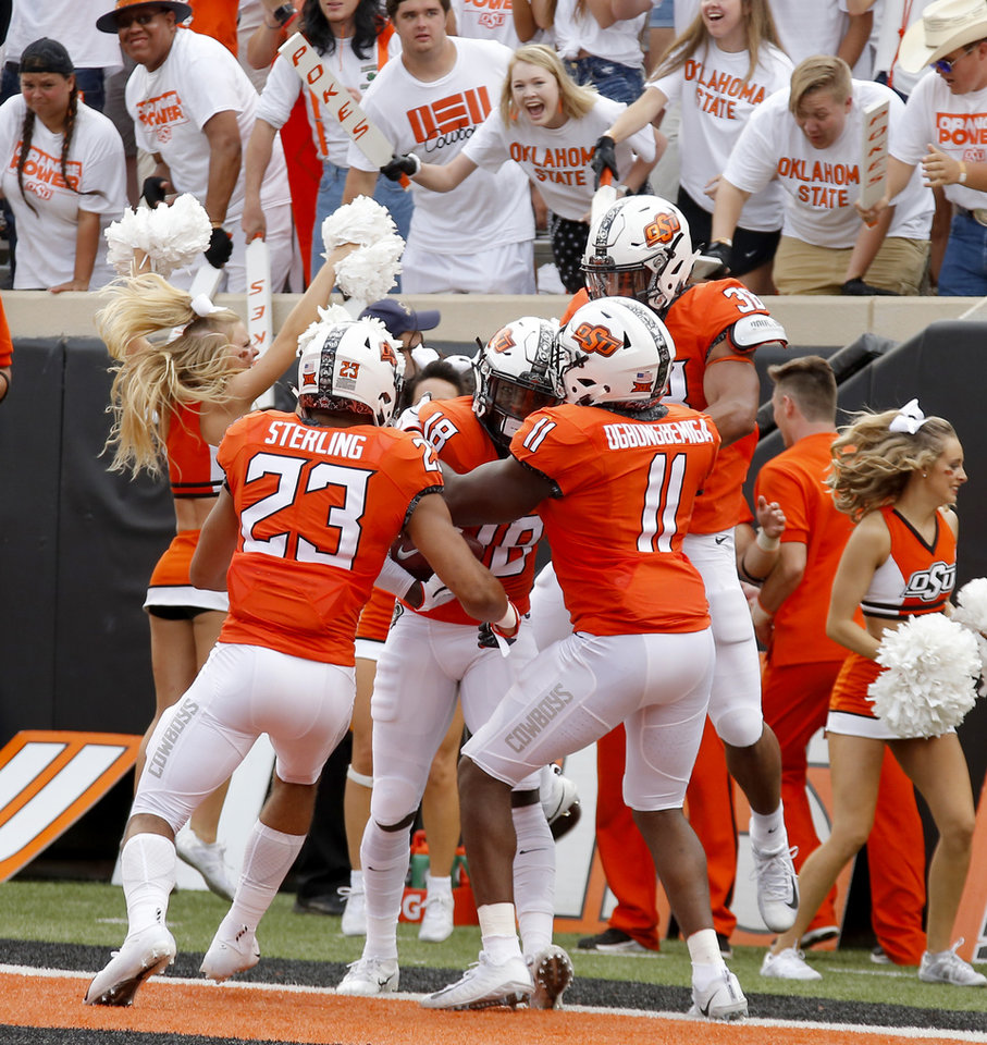 Photo - Oklahoma State's Za'Carrius Green (18) celebrates after returning a blocked punt for a touchdown during a college football game between the Oklahoma State University Cowboys (OSU) and the Boise State Broncos at Boone Pickens Stadium in Stillwater, Okla., Saturday, Sept. 15, 2018. Oklahoma State won 44-21. Photo by Bryan Terry, The Oklahoman