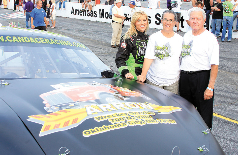 Photo - NASCAR CAR RACER / VANITA MUZNY:  Candace Muzny stands with her parents, Vanita and Al Muzny.
