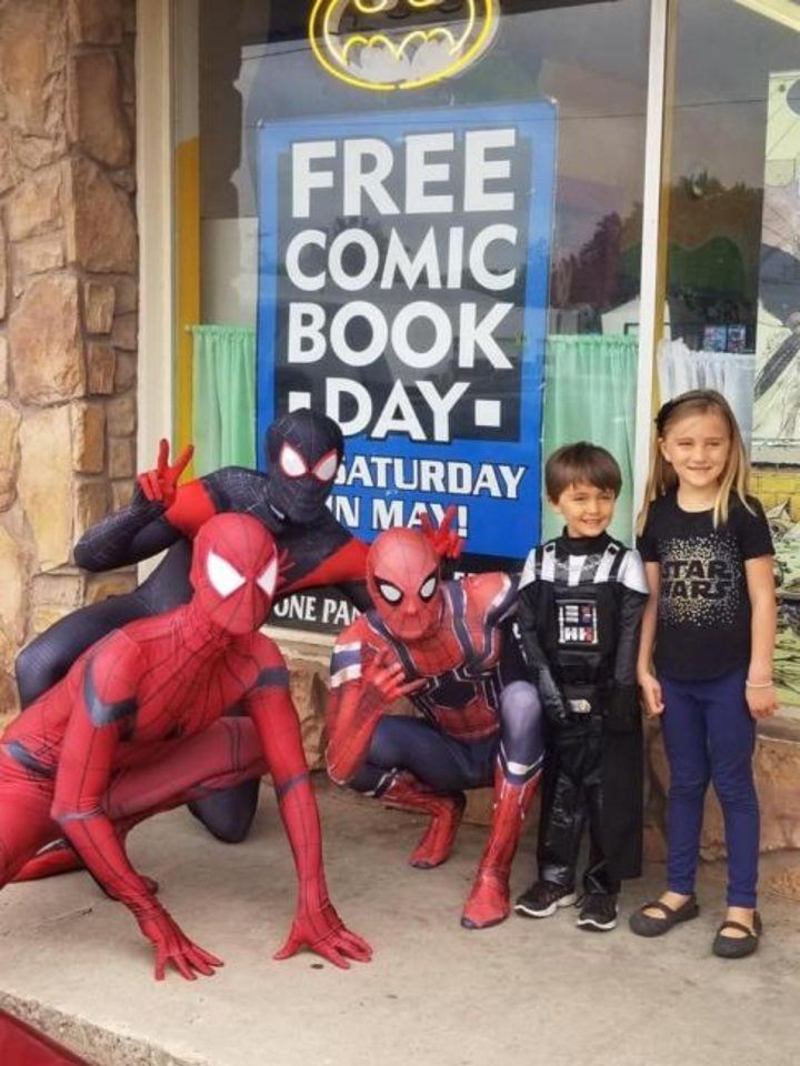 Photo -  Costumed Spidermen entertain kids at Free Comic Book Day at Speeding Bullet Comics in Norman. [Provided]