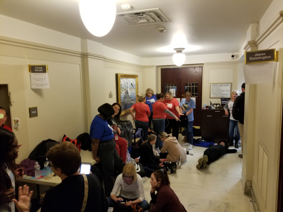 Photo - Teachers line up to enter the Senate viewing gallery on Friday, the fifth day of a statewide teacher walkout. Photo by Ben Felder.