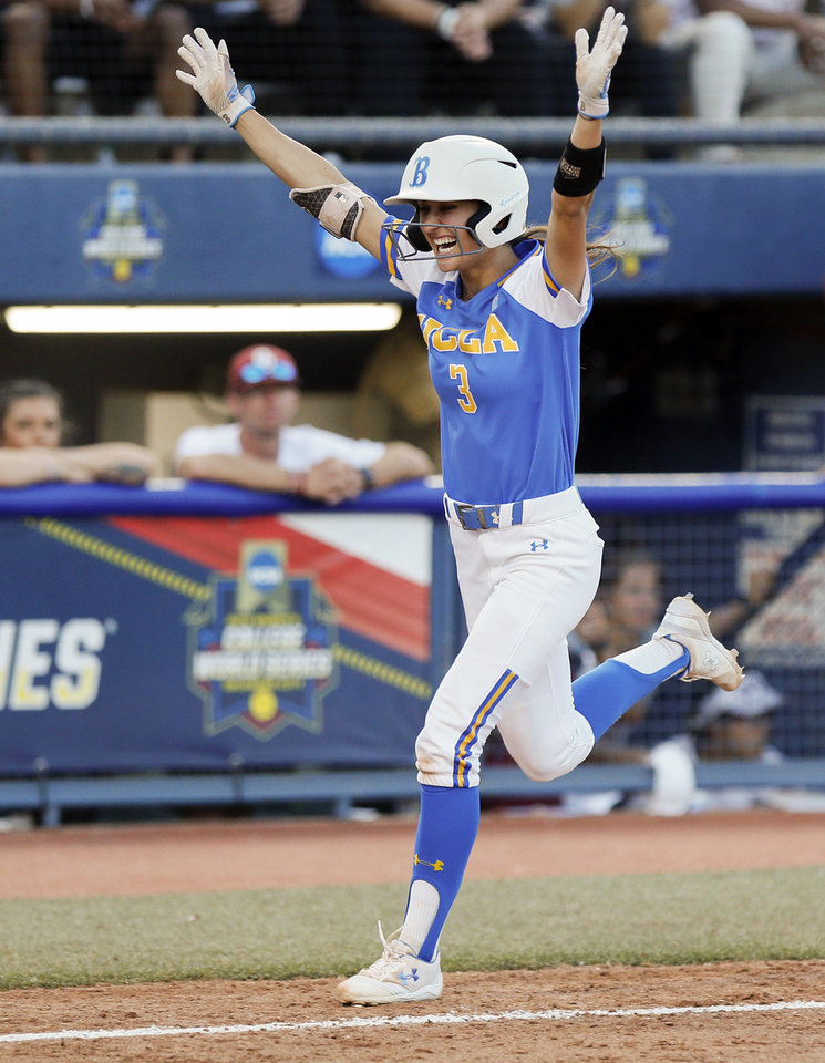 Photo - UCLA's Briana Perez (3) celebrates while heading for home plate on a home run in the sixth inning during the first NCAA softball game in the  championship series of the Women's College World Series between Oklahoma and UCLA at USA Softball Hall of Fame Stadium in Oklahoma City, Monday, June 3, 2019. [Nate Billings/The Oklahoman]