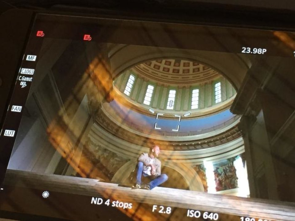 Photo -  A view from a camera monitor shows State Rep. Collin Walke, D-Oklahoma City sitting in the state Capitol building during filming of the documentary