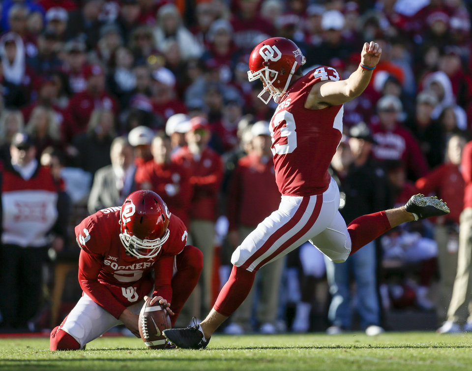 Photo - Oklahoma's Austin Seibert (43) kicks a field goal as Connor McGinnis (3) holds in the second quarter during a Bedlam college football game between the University of Oklahoma Sooners (OU) and the Oklahoma State University Cowboys (OSU) at Gaylord Family-Oklahoma Memorial Stadium in Norman, Okla., Nov. 10, 2018. The field goal made Seibert the all-time scoring leader for OU. Photo by Nate Billings, The Oklahoman