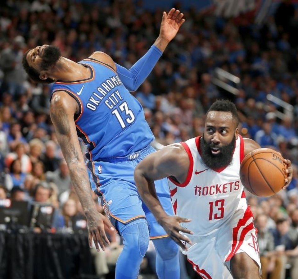 Photo -  Houston's James Harden  is called for an offensive foul as he goes past Oklahoma City's Paul George last season at Chesapeake Energy Arena. [Bryan Terry/Oklahoman archives]