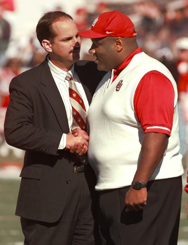 Photo - OU's Athletic Director Joe Castiglione greets Head football Coach John Blake before the game.