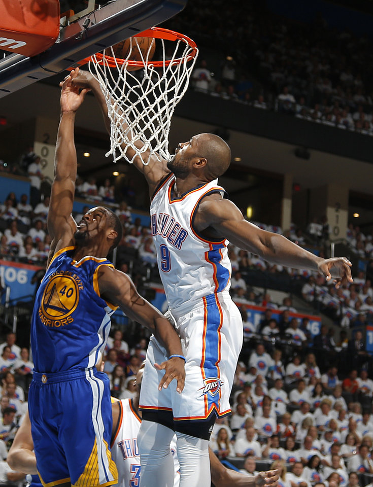 Photo - Oklahoma City's Serge Ibaka (9) blocks the shot of Golden State's Harrison Barnes (40) during Game 4 of the Western Conference finals in the NBA playoffs between the Oklahoma City Thunder and the Golden State Warriors at Chesapeake Energy Arena in Oklahoma City, Tuesday, May 24, 2016. Oklahoma City won 118-94.  Photo by Bryan Terry, The Oklahoman