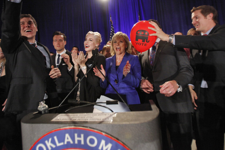 Photo - Governor elect Mary Fallin celebrates her win over Jari Askins with her family at the republican Watch Party at the Marriott on Tuesday, Nov. 2, 2010, in Oklahoma City, Okla.   Photo by Chris Landsberger, The Oklahoman