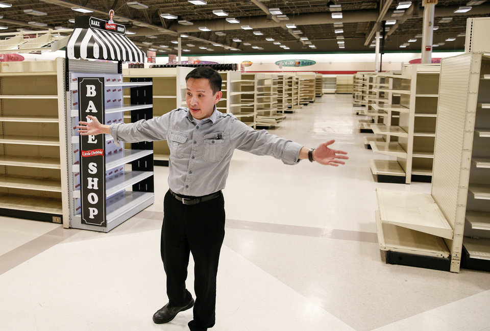Photo -  World Fresh Int'l Market co-owner Quan Nguyen gives a tour of the grocery store being developed in south Oklahoma City on Monday.