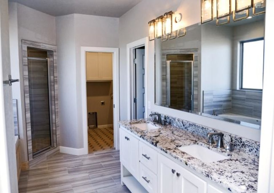 Photo -  Master bathroom of the Denise Patterson home at 6308 NW 178 Terrace. [CHRIS LANDSBERGER/THE OKLAHOMAN]