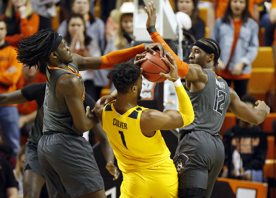 Photo - Oklahoma State's Isaac Likekele (13). left, and Cameron McGriff (12) defend West Virginia's Derek Culver (1) in the first half during a men's college basketball game between the Oklahoma State Cowboys and West Virginia Mountaineers at Gallagher-Iba Arena in Stillwater, Okla., Monday, Jan. 6, 2020. [Nate Billings/The Oklahoman]