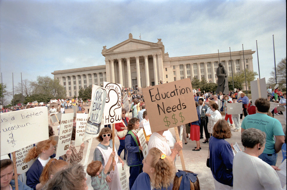 Photo -  Thousands of Oklahoma teachers skipped school on April 16, 1990, to march at the state Capitol for education reforms. The Oklahoma Education Association, which called for the strike, estimated more than 10,000 teachers picketed the Legislature. [Photo by Jim Beckel, The Oklahoman Archives]