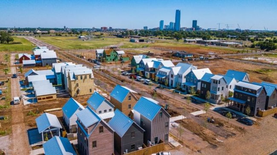 Photo -  Families are starting to move into Wheeler, the new urbanist neighborhood being built at the former Downtown Airpark at 1701 S Western Ave. The Wheeler Ferris wheel, Oklahoma River and downtown skylines can be seen from the homes being built along the former runway. [DAVE MORRIS/THE OKLAHOMAN]