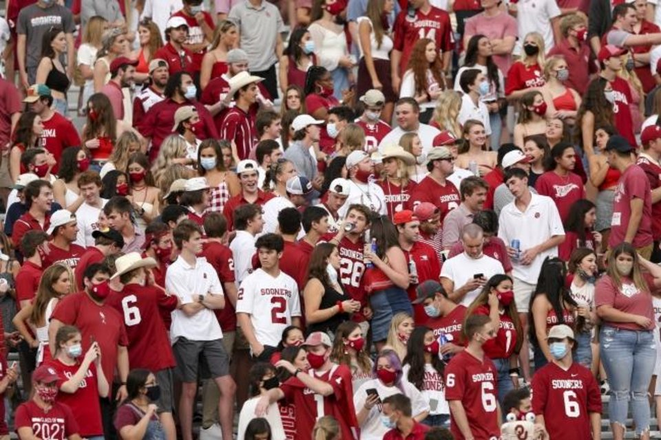 Photo -  Fans in the OU student section stand during the Sooners' 48-0 win against Missouri State on Sept. 12. [Ian Maule/Tulsa World]