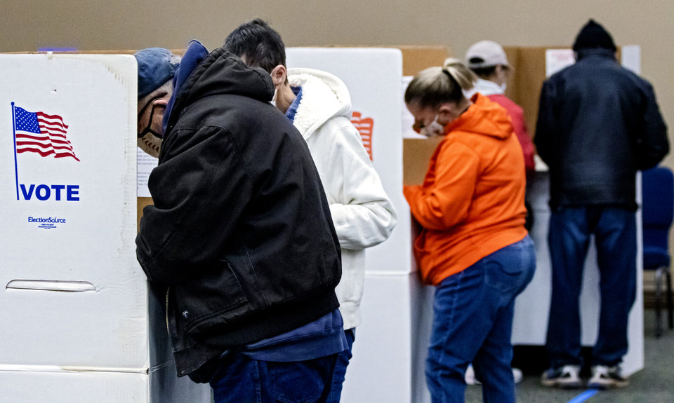 Photo - Voters cast their ballots at the United Methodist Church of the Good Shepherd in Yukon, Okla. on Tuesday, Nov. 3, 2020. [Chris Landsberger/The Oklahoman]