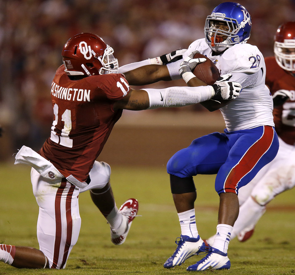 Photo - OU's R.J. Washington (11) tries to bring down KU's James Sims (29) during the college football game between the University of Oklahoma Sooners (OU) and the Kansas Jayhawks (KU) at Gaylord Family-Oklahoma Memorial Stadium in Norman, Okla., Saturday, Oct. 20, 2012. Photo by Bryan Terry, The Oklahoman