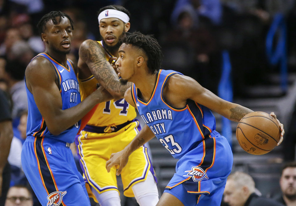 Photo - Oklahoma City's Terrance Ferguson (23) drives as Jerami Grant (9) screens Los Angeles' Brandon Ingram (14) during an NBA basketball game between the Los Angeles Lakers and the Oklahoma City Thunder at Chesapeake Energy Arena in Oklahoma City, Thursday, Jan. 17, 2019. Los Angeles won 128-138 in overtime. Photo by Nate Billings, The Oklahoman