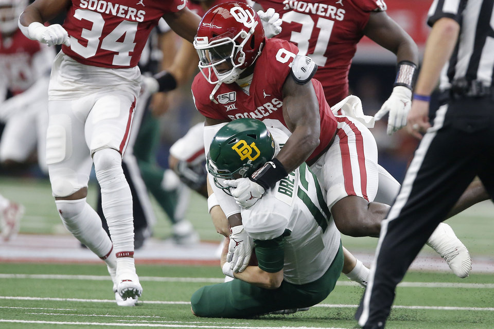 Photo - Oklahoma's Kenneth Murray (9) brings down Baylor's Kalon Barnes (12) during the Big 12 Championship Game between the University of Oklahoma Sooners (OU) and the Baylor University Bears at AT&T Stadium in Arlington, Texas, Saturday, Dec. 7, 2019. Oklahoma won 30-23. [Bryan Terry/The Oklahoman]