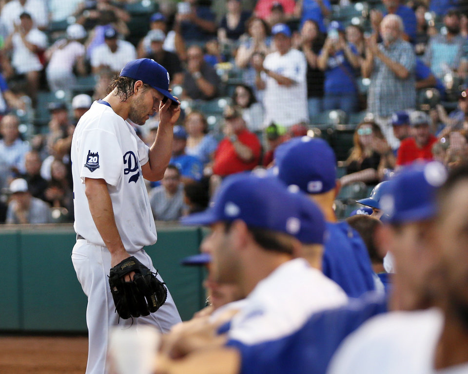 Photo - Clayton Kershaw walks to the dugout after pitching the fourth inning during a Triple-A baseball game between the Oklahoma City Dodgers and the Omaha Storm Chasers at the Chickasaw Bricktown Ballpark in Oklahoma City, Saturday, Aug. 26, 2017. The Los Angeles pitcher threw five innings on a rehab assignment in Oklahoma City. Photo by Nate Billings, The Oklahoman