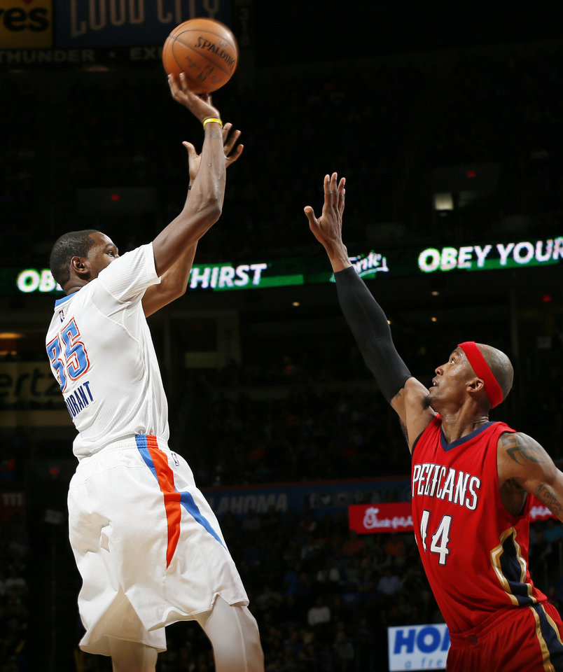 Photo - Oklahoma City's Kevin Durant (35) shoots against New Orleans' Dante Cunningham (44) during an NBA basketball game between the New Orleans Pelicans and the Oklahoma City Thunder at Chesapeake Energy Arena in Oklahoma City, Thursday, Feb. 11, 2016.  Photo by Nate Billings, The Oklahoman
