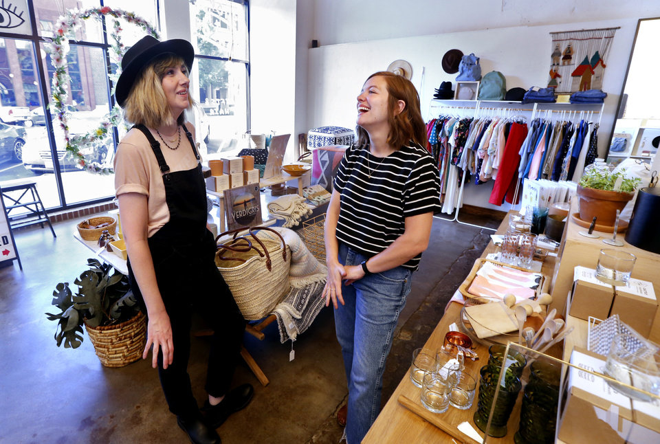 Photo -  Erica Smith, left, and Dana Scott share a laugh at the Social Club Salon and Shop in downtown Norman while discussing their plans to open a second location at West Village along Film Row in Oklahoma City. [Photos by Steve Sisney, The Oklahoman]