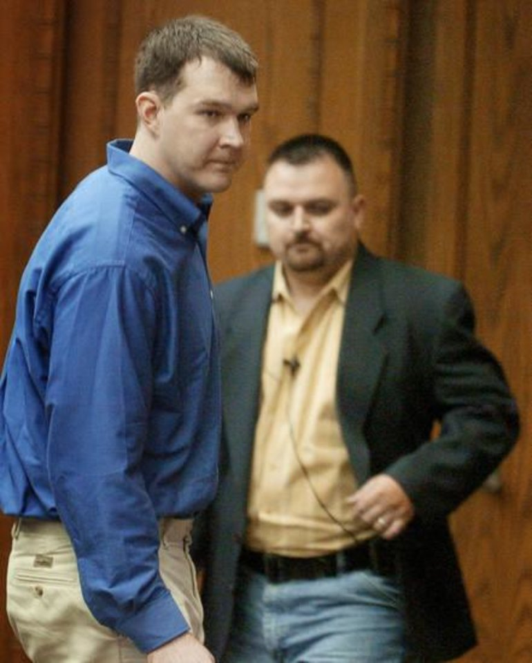 Photo - Rickey Ray Malone, left, leaves the bench after hearing his ate in the sentencing phase for the murder of Oklahoma State Trooper Nikky Joe Green in Lawton, OK, on May 19, 2005. Photo by Steve Sisney/The Oklahoman