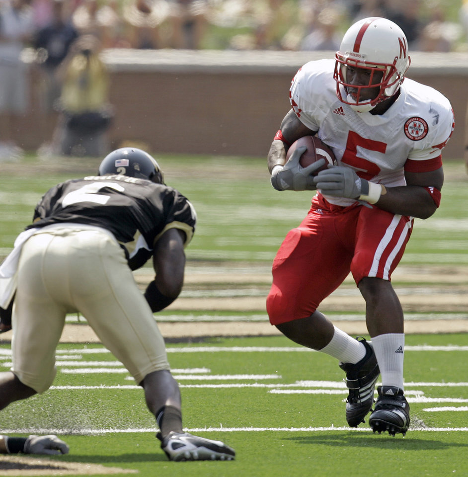 Photo - University of Nebraska's Marlon Lucky (5) tries to avoid the tackle of Wake Forest's Alphonso Smith (2) in the first quarter during a college football game in Winston-Salem, N.C., Saturday, Sept. 8, 2007. (AP Photo/Chuck Burton) ORG XMIT: NCCB102