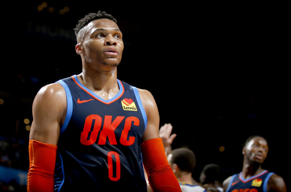 Photo - Oklahoma City's Russell Westbrook (0) walks of the court at half during the NBA basketball game between the Oklahoma City Thunder and the Golden State Warriors at Chesapeake Energy Arena,  Saturday, March 16, 2019. Photo by Sarah Phipps, The Oklahoman