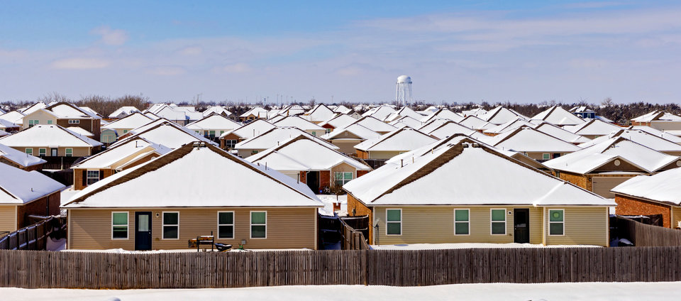 Photo - Snow covered rooftops Oklahoma City, Okla. on Wednesday, Feb. 17, 2021.  [Chris Landsberger/The Oklahoman]