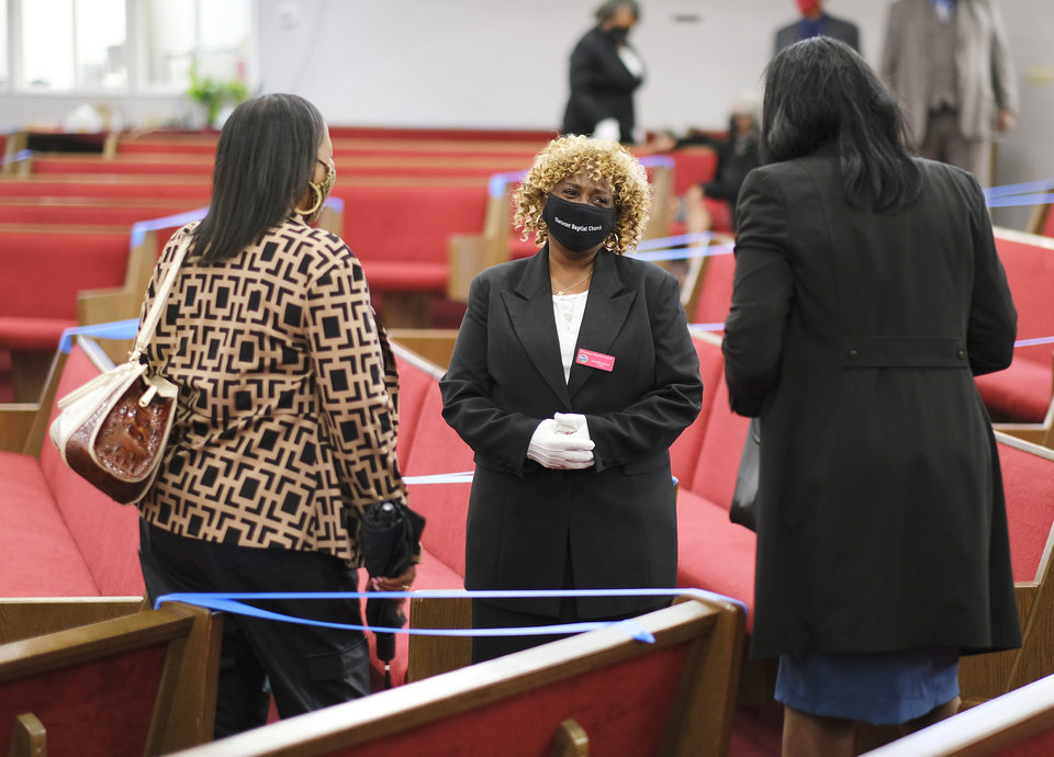 Photo - Jeanise Jones ushers at her church, Ebenezer Missionary Baptist Church led by the Rev. Derrick Scobey. Jones is in the new comedy, Borat 2, by Sasha Baron Cohen. Jones ends up trying to help the girl in the film and gives her wise grandmotherly advice that is apparently a big hit among people who have watched the film in the UK and word is slowly getting around about her here in the U.S. as well.   Sunday, October 25, 2020. [Doug Hoke/The Oklahoman]