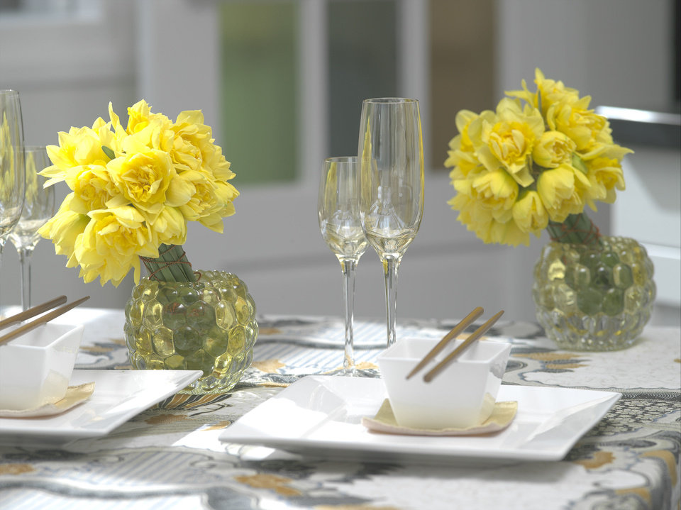 Photo - Small bunches of bright yellow blooms can be placed around a brunch table for sunny pops of color. Photo provided by iBulb.  Steven Bemelman