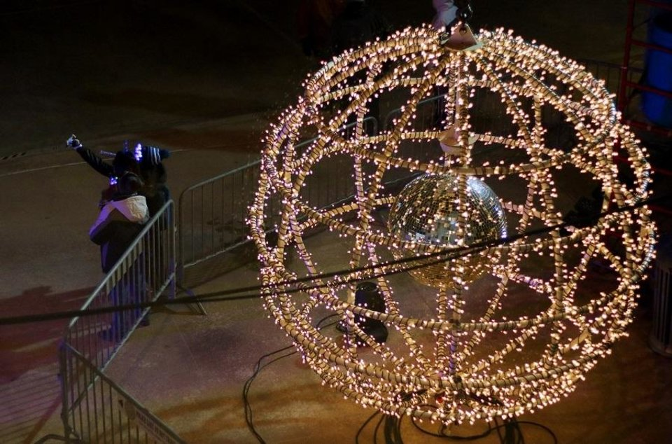 Photo - People take selfies in front of the giant lighted ball at Opening Night 2019 in Bicentennial Park in downtown Oklahoma City, Monday, December 31, 2018. [Doug Hoke/The Oklahoman Archives]