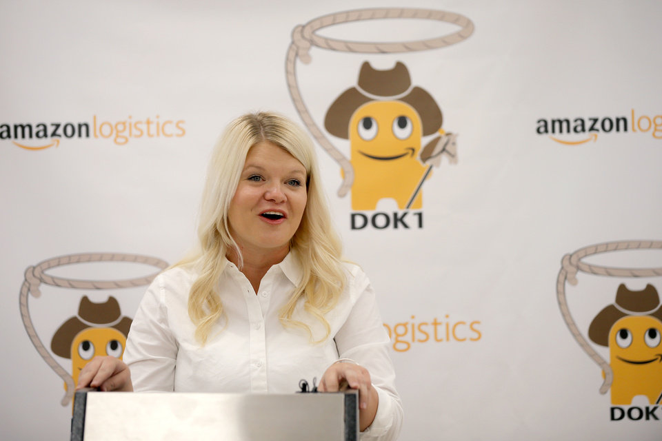 Photo -  Straightaway Delivery co-owner Erica Stone talks about the new company's partnership with Amazon on Tuesday inside the new Amazon Delivery Center.