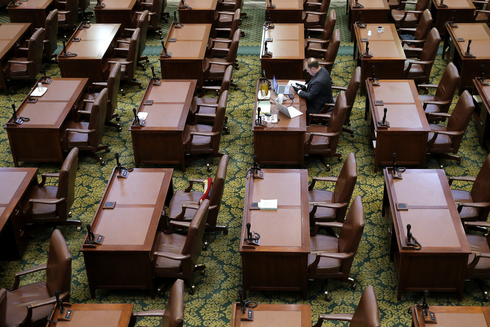 Photo - Rep. Jon Echols sits at his desk during a special session of the House of Representatives at the state Capitol in Oklahoma City, Monday, April 6, 2020. A skeleton crew of lawmakers was allowed in the House chamber as others watched from their offices during a special session of the House of Representatives. [Bryan Terry/The Oklahoman]
