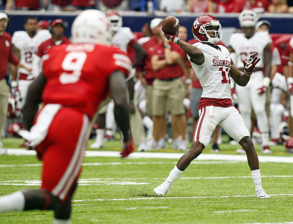Photo - Oklahoma's Dede Westbrook (11) attempts a pass during the AdvoCare Texas Kickoff college football game between the University of Oklahoma Sooners (OU) and the Houston Cougars at NRG Stadium in Houston, Saturday, Sept. 3, 2016. Houston won 33-23. Photo by Nate Billings, The Oklahoman